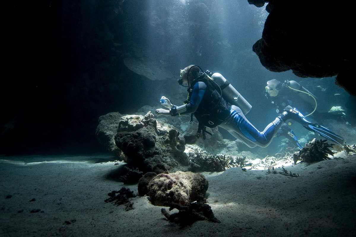 team-of-scuba-divers-whilst-exploring-underwater-treasures